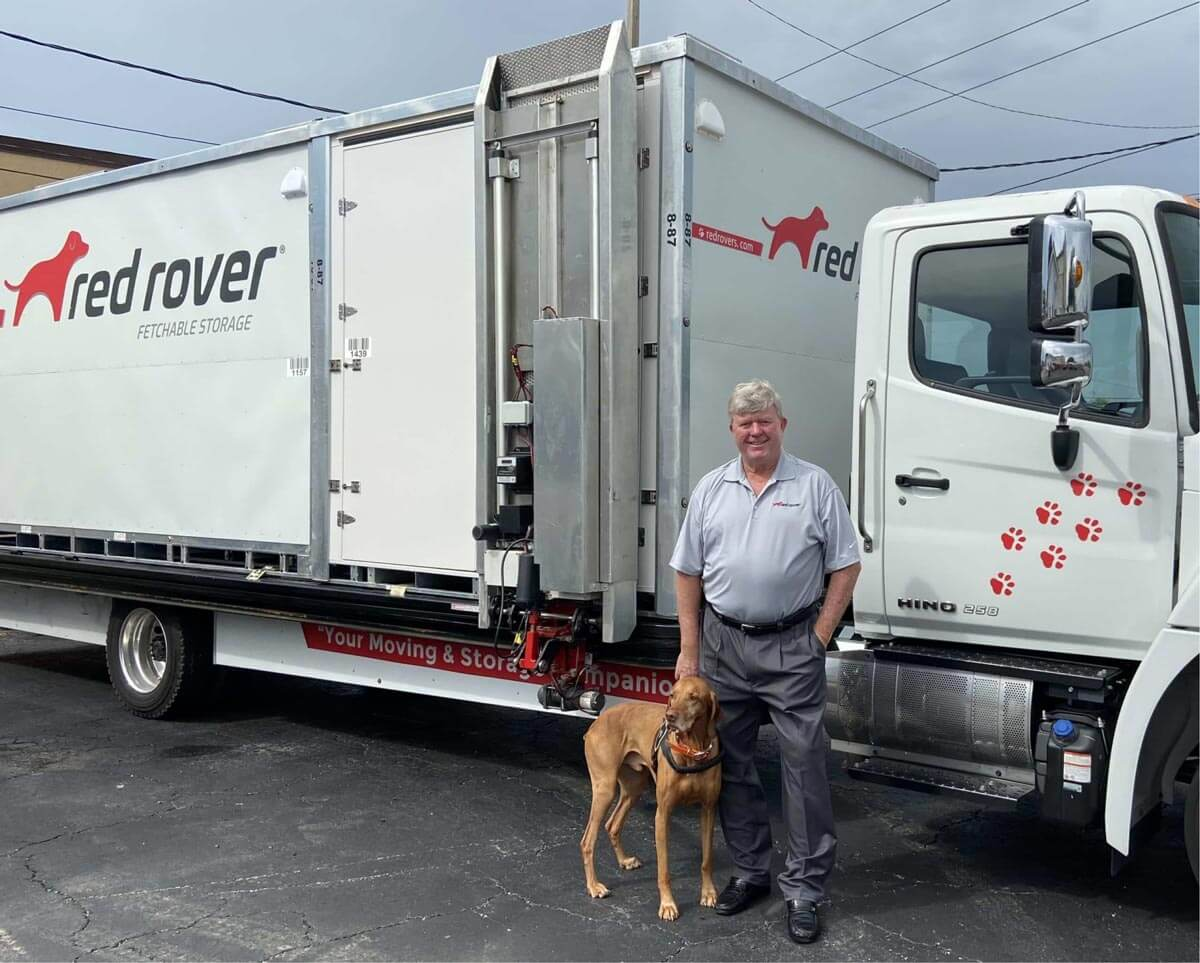 Peter Warhurst - Red Rover CEO with truck and dog